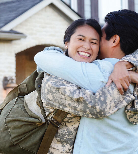 veteran hugging husband